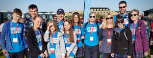 Large group of people finishing the Kiltwalk in Dundee
