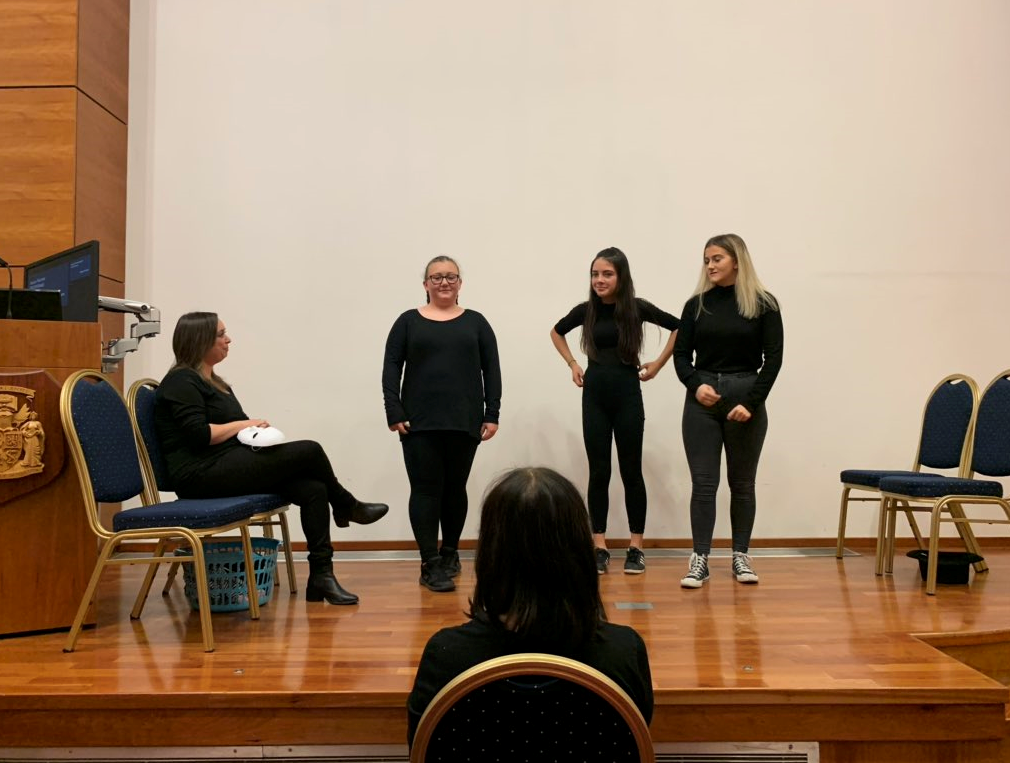 Young people performing a play