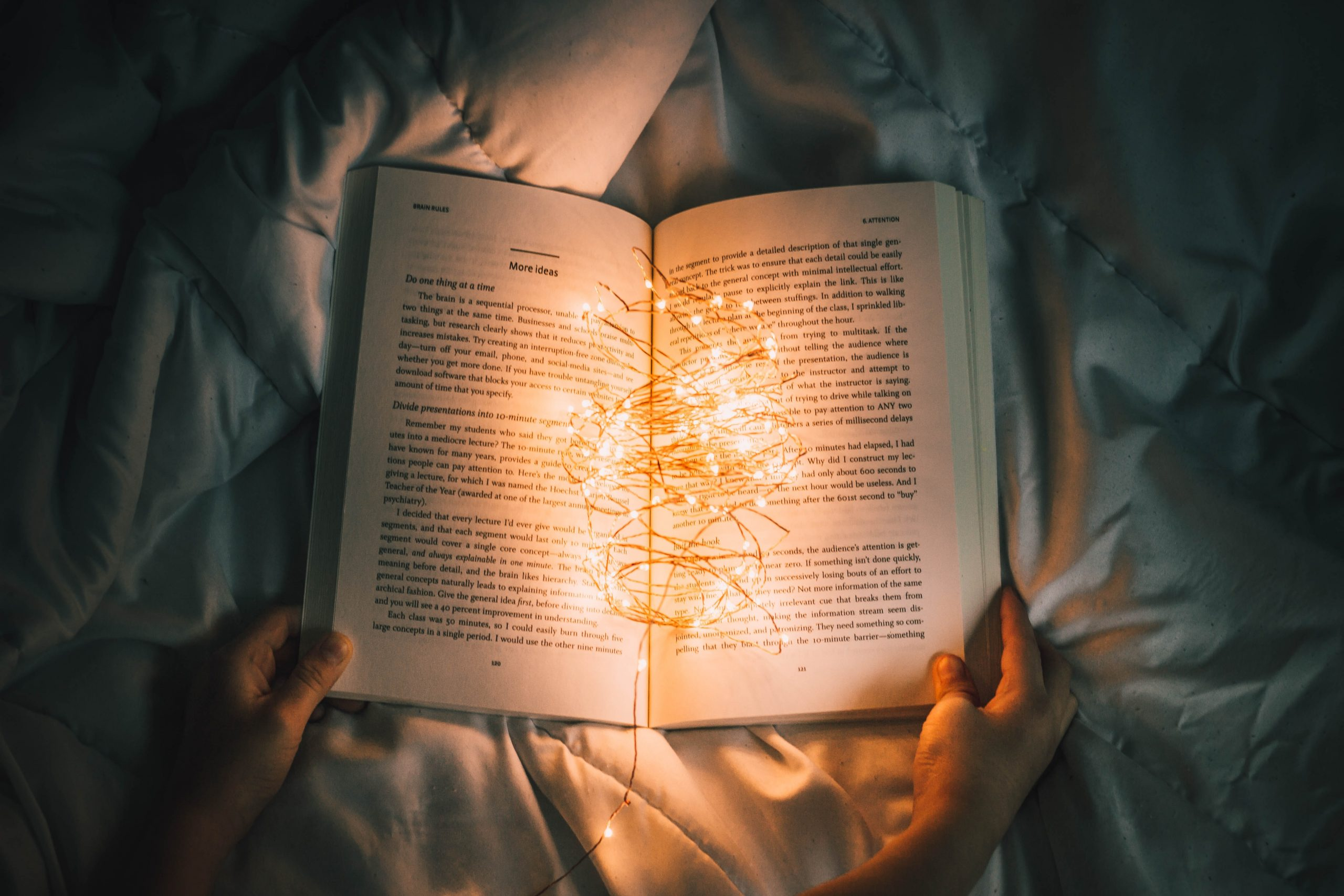 storybook lying open on a quilt covered in lights