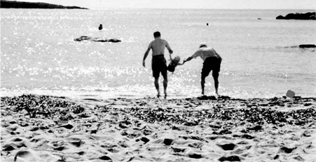 People on the Beach with Child